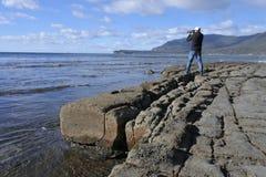 Travel photographer photographing Tessellated Pavement in Tasman Peninsula Tasmania Australia. Travel photographer photographing the landscape view of the stock photos