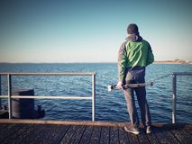 Travel photographer on pier. Photo shooting during sunny autumnal afternoon Stock Image