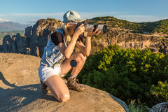 Travel photographer. A travel photographer takes pictures of the spectacular monasteries of Meteora, Central Greece. Panoramic view from the best existing view Stock Photography