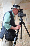 Travel photographer at work Royalty Free Stock Photos