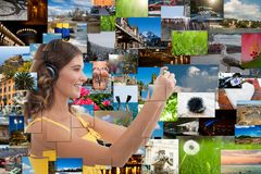 Travel photography. Multimedia world - girl with photos from her travels shooting from phone royalty free stock images