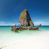 Travel photography of wooden boats on shore of tropical sea Stock Photography
