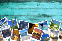 Travel photos on turquoise wood background. Heap of travel photos on azure wood background Stock Images