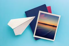 Travel pictures hanging on blue background, collage. Travel pictures and paper plane hanging on blue background, collage royalty free stock images