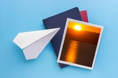 Travel pictures hanging on blue background, collage. Travel pictures and paper plane hanging on blue background, collage royalty free stock photography