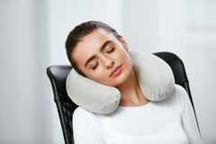 Travel Pillow. Woman With Pillow On Neck. Travel Pillow. Young Woman With Pillow On Neck Sitting In Chair. High Resolution stock photography