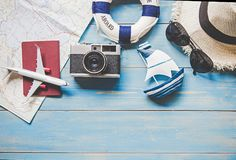 Travel Plan. Traveler planning trip summer travel on the beach with Traveler accessories, retro camera, airplane and passport,. Vintage tone style. Travel and royalty free stock images