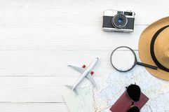 Travel Plan. Traveler planning trip summer travel on the beach with Traveler`s accessories, retro camera, airplane and passport, Stock Photography