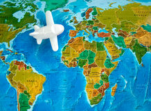 Travel by plane. Concept; white toy plane on a map background Stock Photography
