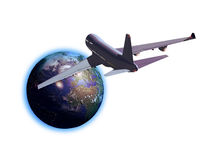 Travel by plane. A plane flying toward the Earth Royalty Free Stock Photo