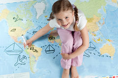 Travel planning. Little girl planning travel around the world Stock Photo