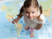 Travel planning. Little girl planning travel around the world Stock Photography