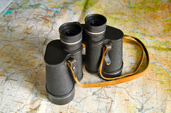 Travel planning. Black binoculars on geological map Stock Photography