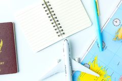 Travel Planning accessories, Airplane,wallet, sun glasses, money. Note pad, jeans, action camera,world map and passport with blank space on white background Stock Photo