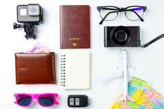 Travel Planning accessories, Airplane,wallet, sun glasses, money. Note pad, jeans, action camera,world map and passport with blank space on white background Royalty Free Stock Image