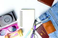 Travel Planning accessories, Airplane, wallet,sun glasses, money. Note pad, jeans, action camera,world map and passport with blank space on white background Royalty Free Stock Photos