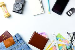 Travel Planning accessories, Airplane, wallet,sun glasses, money. Note pad, jeans, action camera,world map and passport with blank space on white background Royalty Free Stock Images
