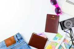 Travel Planning accessories, Airplane, wallet,sun glasses, money. Note pad, jeans, action camera,world map and passport with blank space on blue background Stock Photo