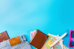 Travel Planning accessories, Airplane, wallet,sun glasses, money. Note pad, jeans, action camera,world map and passport with blank space on blue background Stock Photography