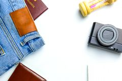 Travel Planning accessories, Airplane, wallet,sun glasses, money. Note pad, jeans, action camera,world map and passport with blank space on white background Royalty Free Stock Photography