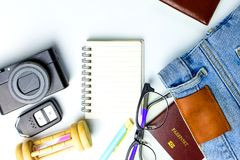Travel Planning accessories, Airplane, wallet,sun glasses, money. Note pad, jeans, action camera,world map and passport with blank space on white background Royalty Free Stock Image