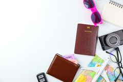 Travel Planning accessories, Airplane, wallet,sun glasses, money. Note pad, jeans, action camera,world map and passport with blank space on white background Stock Image