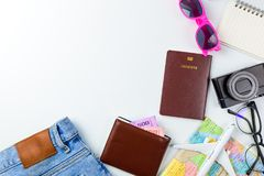 Travel Planning accessories, Airplane, wallet,sun glasses, money. Note pad, jeans, action camera,world map and passport with blank space on blue background Stock Image