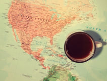 Travel planning concept with coffee cup over the map Royalty Free Stock Photo