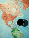 Travel planning concept with coffee cup over the map Stock Photos