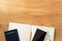 Travel planning concept with passport, cellphone, earphone, penc Royalty Free Stock Photography