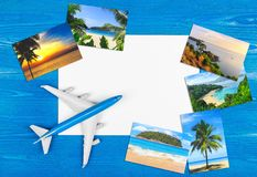 Travel by plane. Tropical resort. Advertising of company. Hotel booking. Travel planning concept on table royalty free stock photography