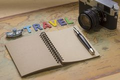 Travel planning concept top view. Taking notes to notebook on map background, copy space for text Stock Photography