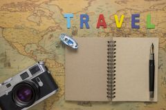 Travel planning concept top view. Taking notes to notebook on map background, copy space for text Stock Photo