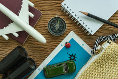 Travel planning concept with toy airplane, passport, compass, bi royalty free stock image