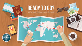 Travel planning. Explorer planning a trip around the world, he is tracing the route on the map, travel and adventure concept Royalty Free Stock Images