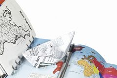 Travel planning (a notebook and a paper ship) Royalty Free Stock Photo
