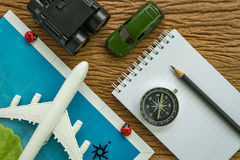 travel planning road trip concept with airplane, passport, compa Royalty Free Stock Image