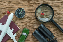 travel planning road trip concept with toy airplane, passport, c Royalty Free Stock Photo