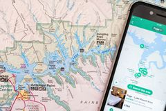 Travel planning with smart phone and travel map, detail of Arizona, USA map, Lake Powell. Travel planning with accessories, smart phone and travel map, detail of royalty free stock photo
