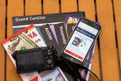 Travel planning to USA, camera, smart phone and travel maps, various USA maps stock photo