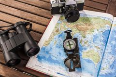 Top view of binoculars, compass, photocamera and map Royalty Free Stock Photo