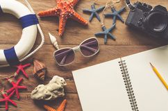 Travel planning and travel accessories on wooden floors Royalty Free Stock Photos