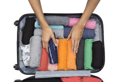 Travel planning and a traveler packing a luggage Stock Photos