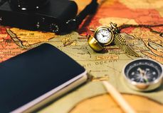 Travel planning vintage style. Watch compass and camera Royalty Free Stock Photo