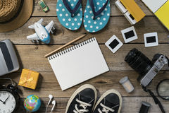 Travel planning on wooden background Stock Images