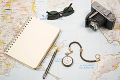Travel plans with map of island Greece and objects. Camera,sun glasses pocket watch and notebook. Map of Greek island Lefkas with objects. Vintage camera, sun Royalty Free Stock Image