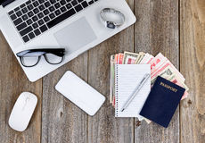Travel plans on wooden desktop Royalty Free Stock Photos