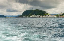 Travel in pleasure motorboat in Norwegian Sea near Alesund, Norway. Alesund is a famous resort and tourist city in Norway stock photo