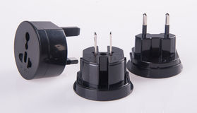 Travel plug adapter on a background Stock Photo