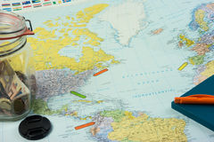 Travel preparations: Map with different items and location markers stock photography